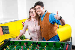A happy couple playing foosball